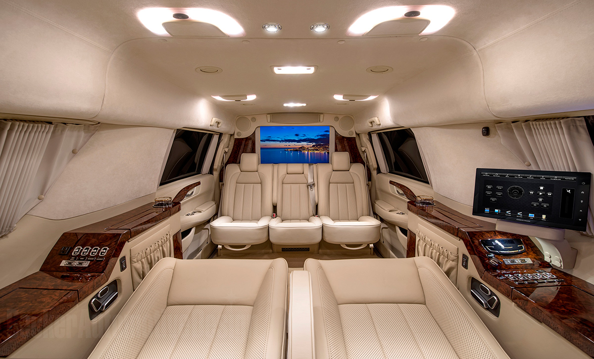 custom stretched cadillac escalade evs offers private jet like interior. Black Bedroom Furniture Sets. Home Design Ideas