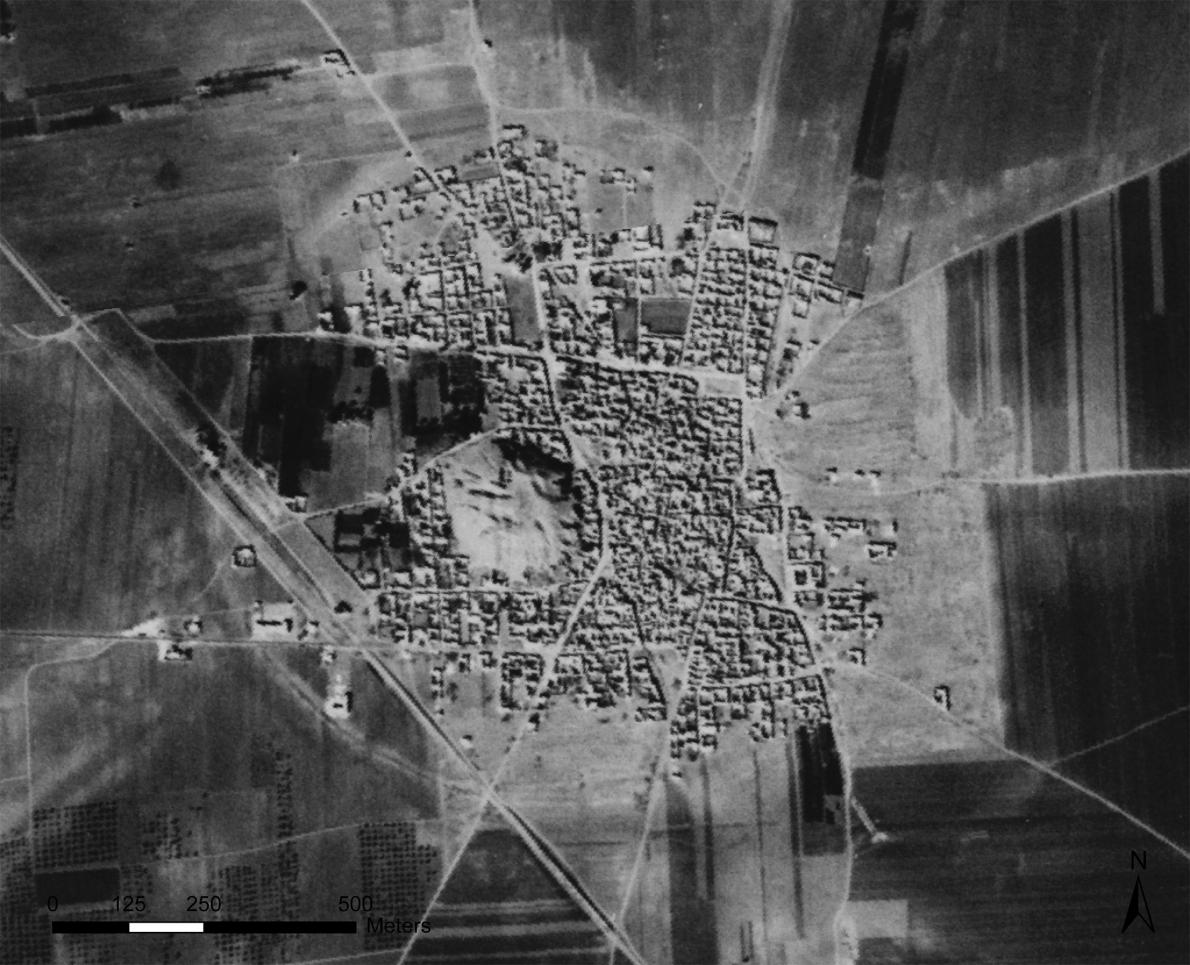 This 1961 satellite photo shows Tell Rifaat in northwest Syria; it's now completely surrounded by a modern town. (CORONA ATLAS PROJECT)