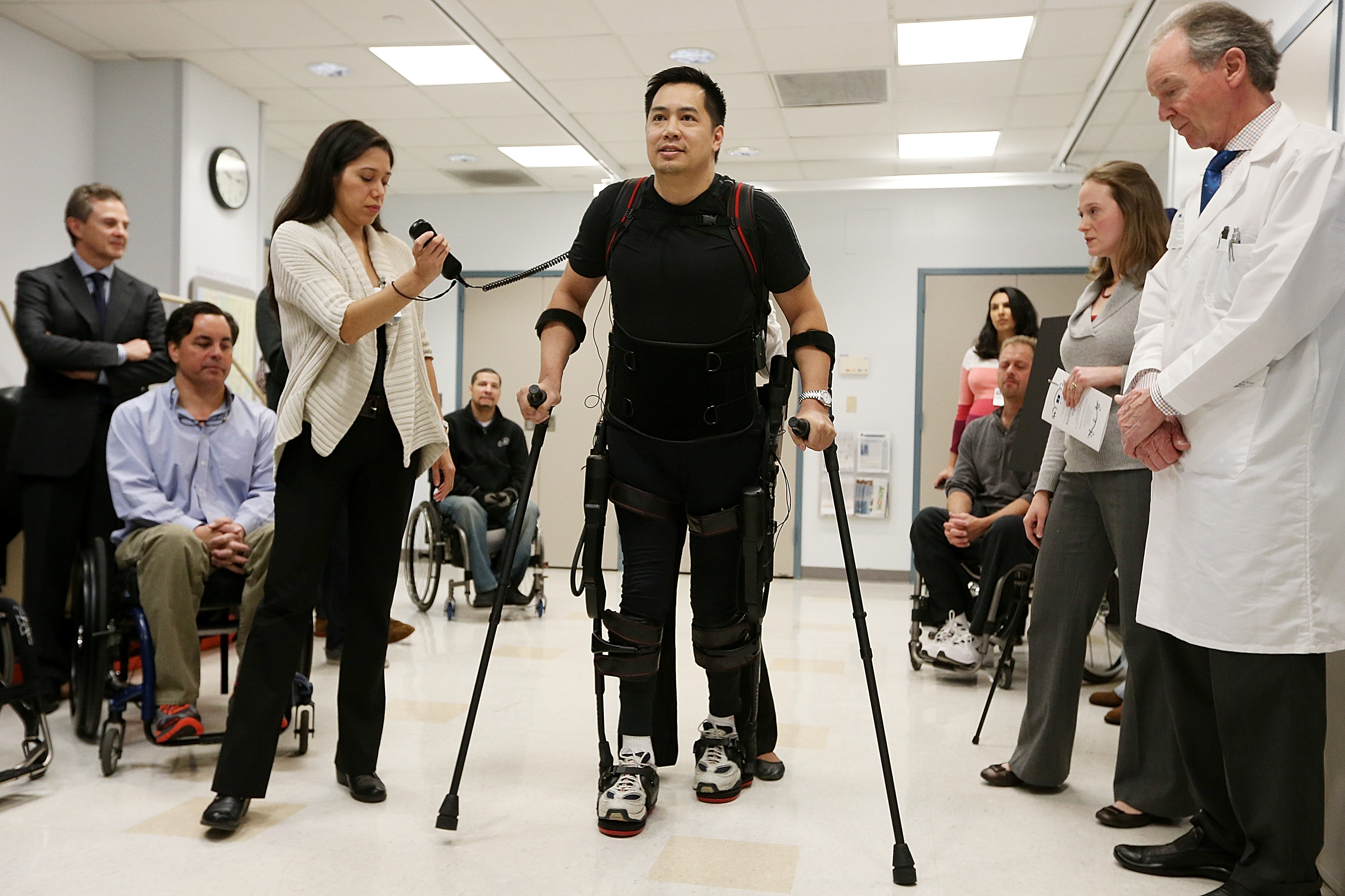 Forty three-year-old parapalegic Robert Woo walks with an exoskeleton device made by Ekso Bionics during a demonstration at the opening of the Rehabilitation Bionics Program at Mount Sinai Rehabilitation Center on December 6, 2012 in New York City. Woo is an architect who was paralyzed from the hips down during a construction accident and thought he would never walk again. The new strap-on exoskelton uses motors and sensors to physically move the legs. (Mario Tama/Getty Images)