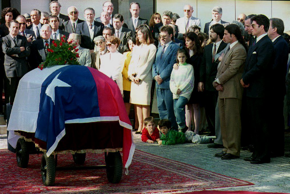 Relatives and friends of former Chilean Minister of Foreign Affairs Orlando Letelier gather next to the coffin bearing his remains on November 4,1992. Cris Bouronicle/AFP/Getty Images)