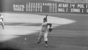 (Original Caption) The Writing on the Wall. New York: Yankee hurler Don Larsen studies the scoreboard at Yankee Stadium in the top of the 8th inning as he neared the feat of pitching the first perfect game in World Series history to give the Yankees a 2-0 victory over the Dodgers and a 3-to-2 game lead in the 1956 classic. The 27-year-old right hander threw only 97 pitches as he turned back 27 Dodgers in a row, seven of them on strikeouts. Larsen, who disdained any wind-up against the Dodgers, became the seventh man in all of baseball history to pitch a perfect game.