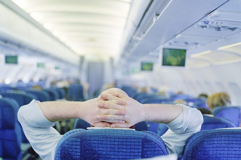Man relaxing in an airplane (Getty Images)