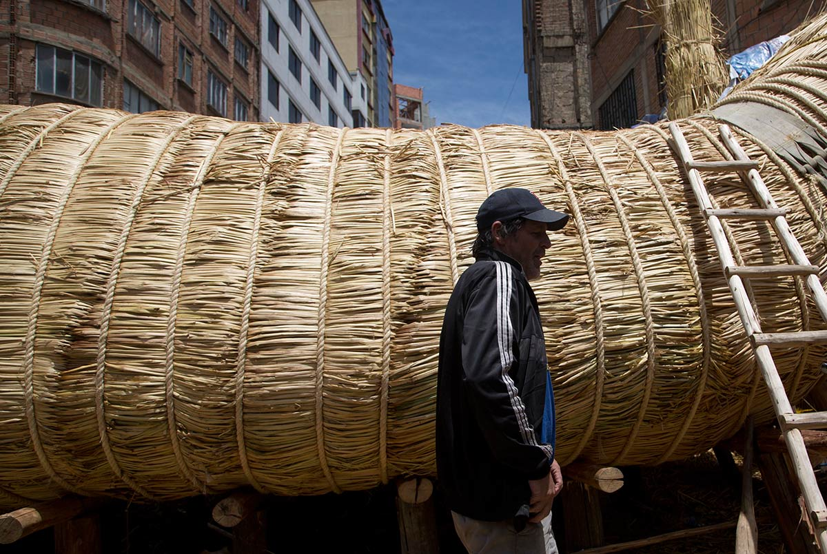 American explorer Phil Buck walks past the reed boat built by Bolivian Aymara Indians, in La Paz, Bolivia, Wednesday, Oct. 19, 2016. (Juan Karita/AP)