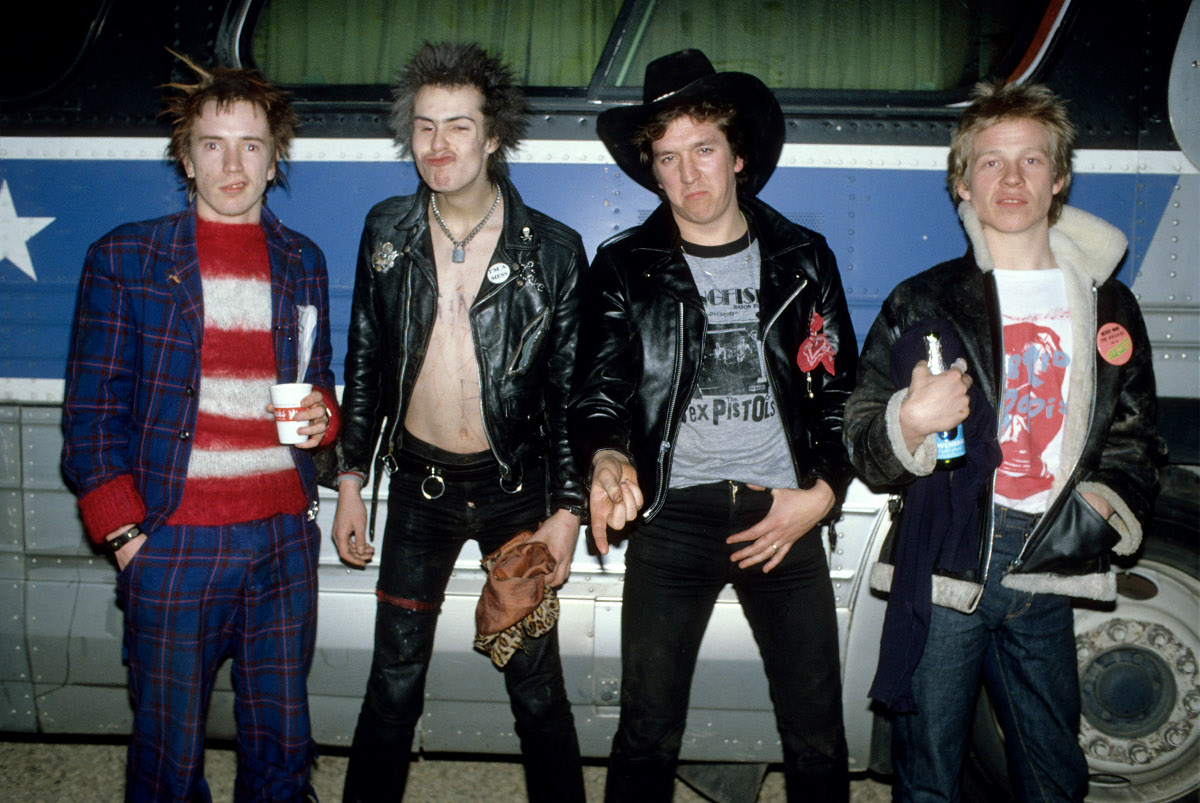 The Sex Pistols pose for a portrait in front of their tour bus during the band's final tour. (Richard E. Aaron/Redferns)