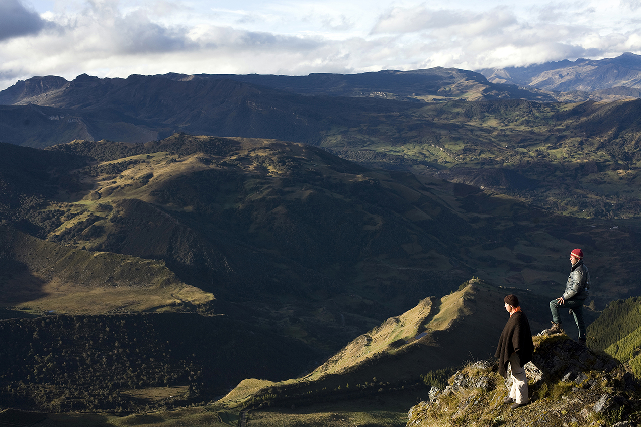 Two hikers look upon the lands they have traversed in El Cocuy, Colombia (Getty Images)
