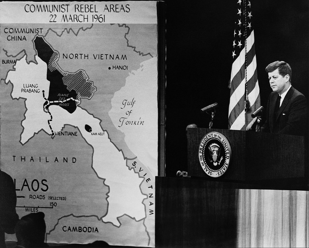 President Kennedy during a 1961 press conference that involved a CIA map showing the distribution of rebel actors in Vietnam. (Central Intelligence Agency)