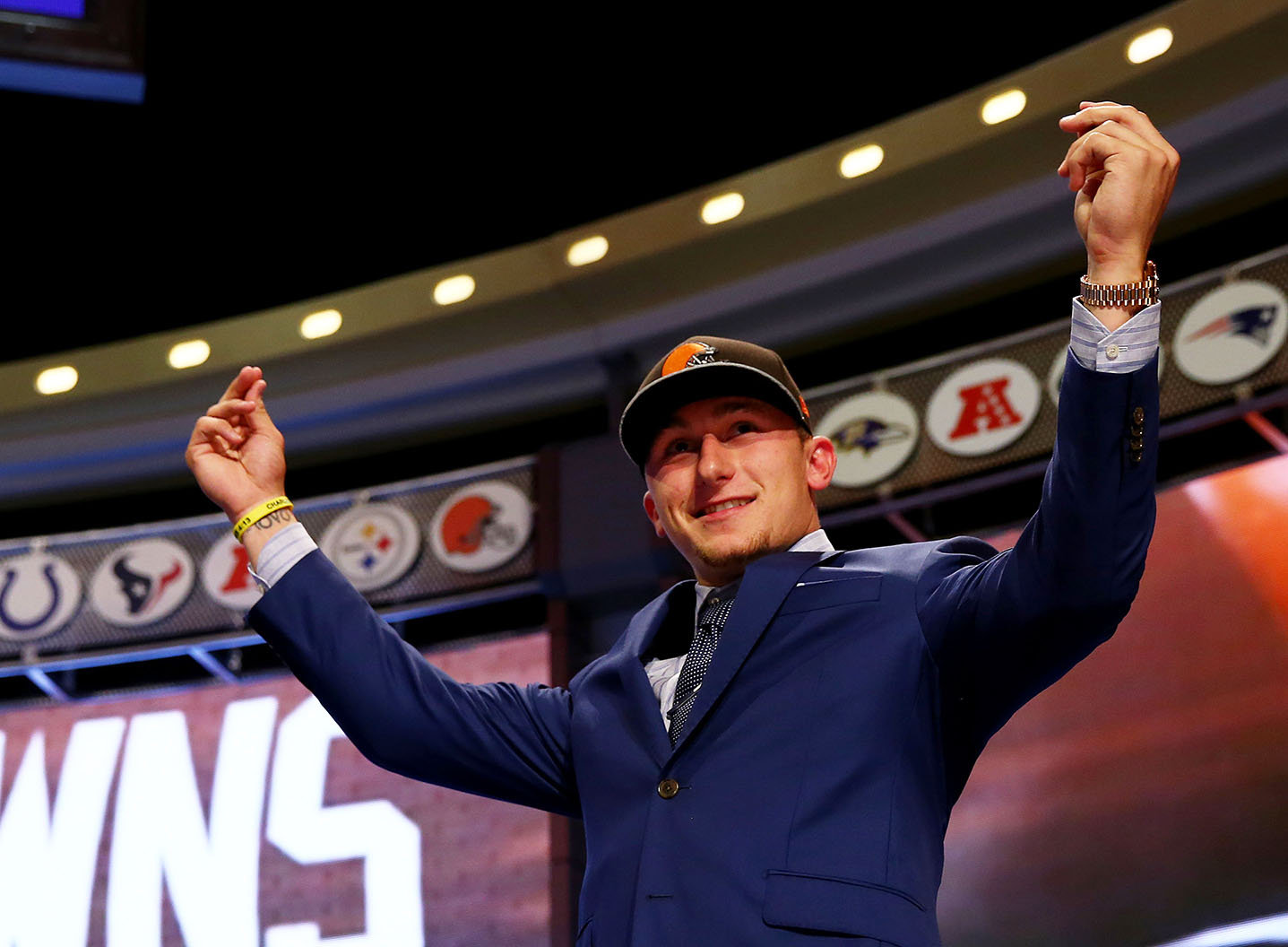 Johnny Manziel of the Texas A&M Aggies takes the stage after he was picked #22 overall by the Cleveland Browns during the first round of the 2014 NFL Draft at Radio City Music Hall on May 8, 2014 in New York City. (Elsa/Getty Images)
