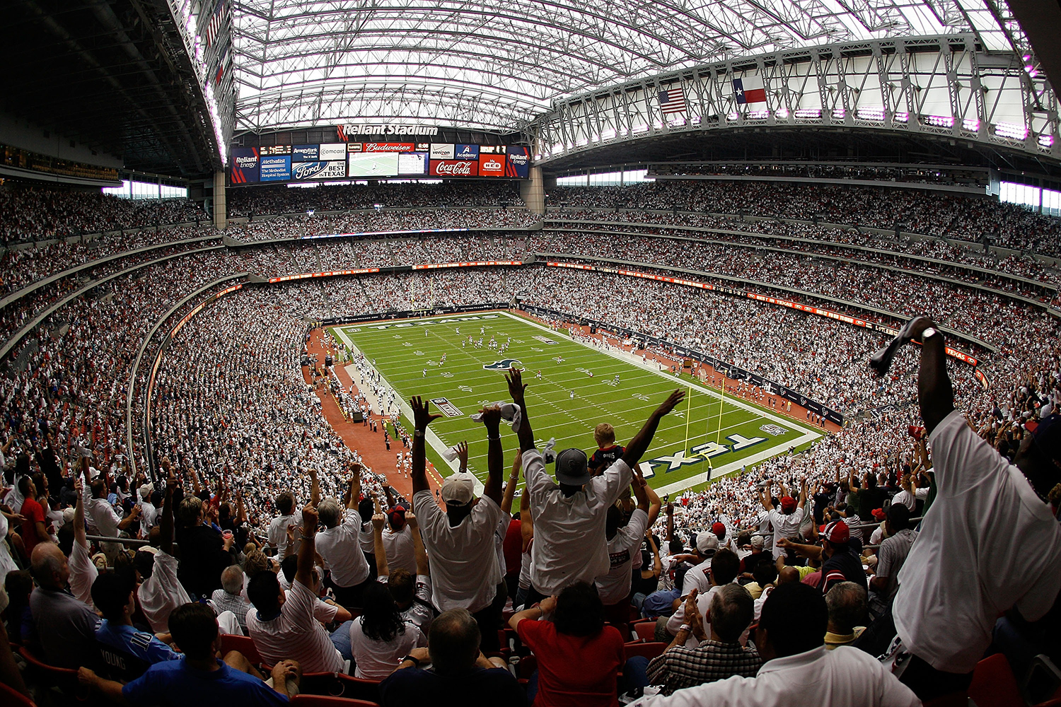 Fans celebrate a touchdown at NRG Stadium, formerly Reliant Stadium, in Houston, Texas. (Chris Graythen/Getty Images)
