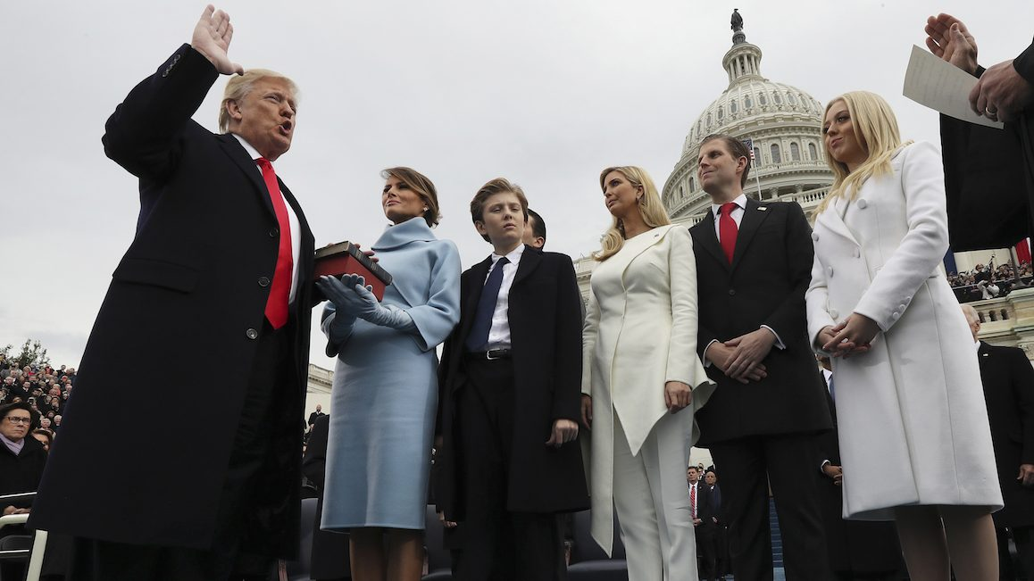 U.S. President-elect Donald Trump, left, takes the oath of office as U.S. First Lady-elect Melania Trump stands the 58th presidential inauguration in Washington, D.C., U.S., on Friday, Jan. 20, 2017. Donald Trump will become the 45th president of the United States today, in a celebration of American unity for a country that is anything but unified. Photographer: Jim Bourg/Pool via Bloomberg