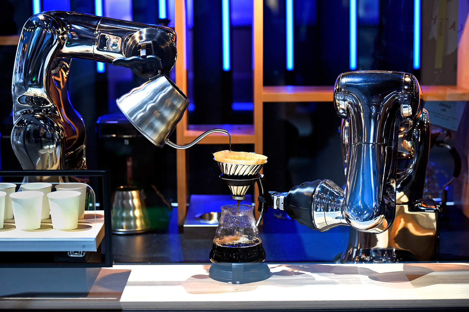 Robotic arms make coffee in a demonstration using a pair of VS-S2 Series robots at the Denso booth at CES 2017 at the Las Vegas Convention Center on January 5, 2017 in Las Vegas, Nevada. CES, the world's largest annual consumer technology trade show, runs through January 8 and features 3,800 exhibitors showing off their latest products and services to more than 165,000 attendees. (David Becker/Getty Images)
