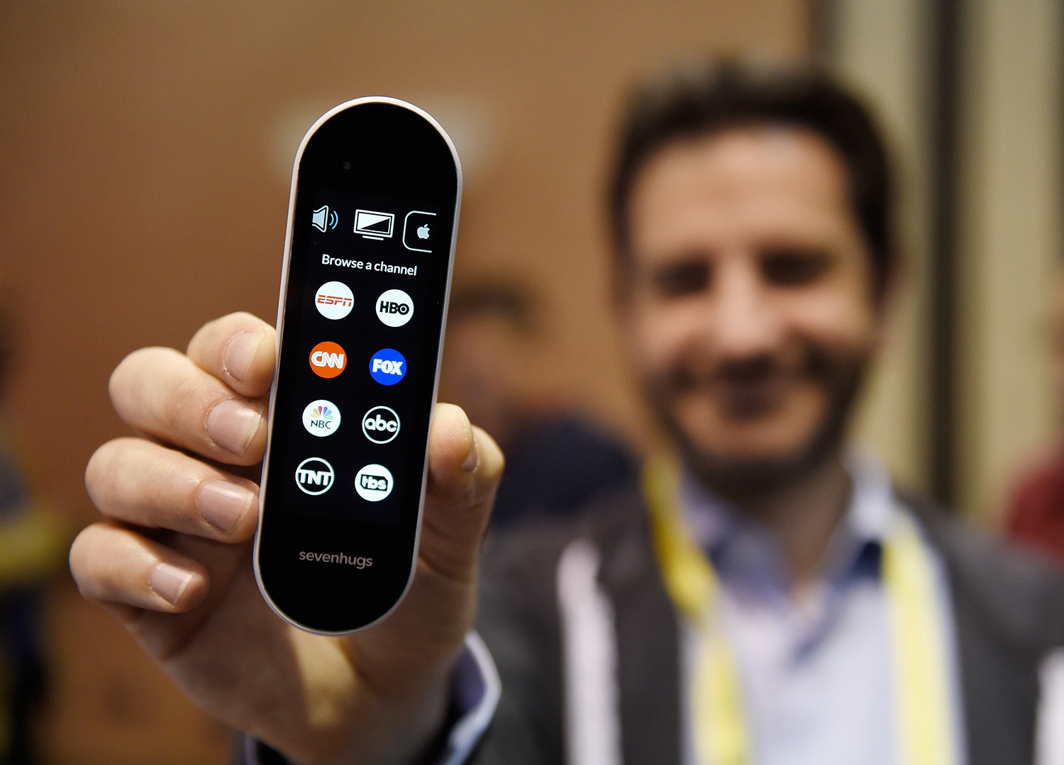 Simon Tchedikian displays a Sevenhugs smart remote during a press event for CES 2017 at the Mandalay Bay Convention Center on January 3, 2017 in Las Vegas, Nevada. The USD 299 device is designed as a universal remote to operate many household devices and is scheduled to be released in June 2017. CES, the world's largest annual consumer technology trade show, runs from January 5-8 and is expected to feature 3,800 exhibitors showing off their latest products and services to more than 165,000 attendees. (David Becker/Getty Images)