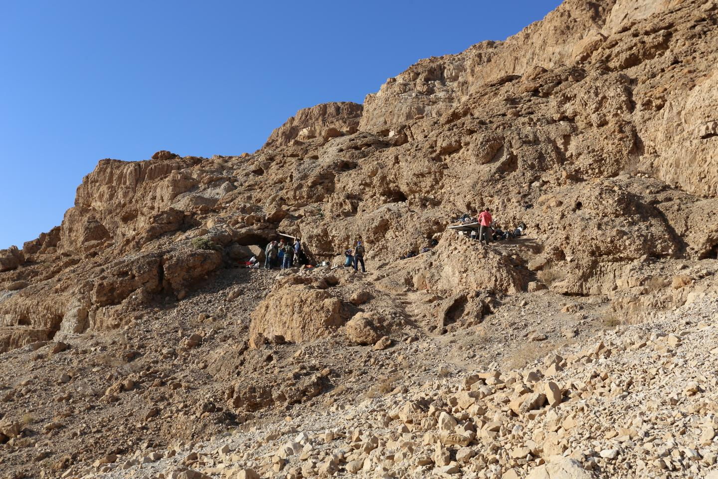 Fault cliff and entrance, on the left, to a cave near the Dead Sea, excavated by Hebrew University archaeologists, who designated it the 12th Dead Sea Scrolls cave. (Casey L. Olson and Oren Gutfeld)