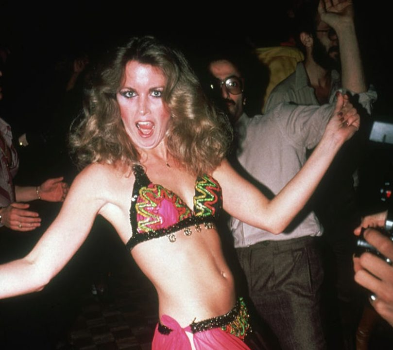 An unidentified party-goer dances in a bikini and transparent skirt at the nightclub Studio 54, New York, New York, late 1970s or early 1980s. (Photo by Rose Hartman/Getty Images)