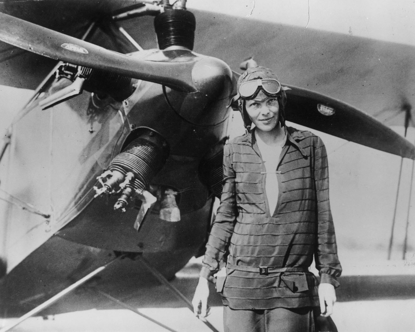 """Amelia Earhart stands June 14, 1928 in front of her bi-plane called """"Friendship"""" in Newfoundland. Earhart (1898 - 1937) disappeared without trace over the Pacific Ocean in her attempt to fly around the world in 1937."""