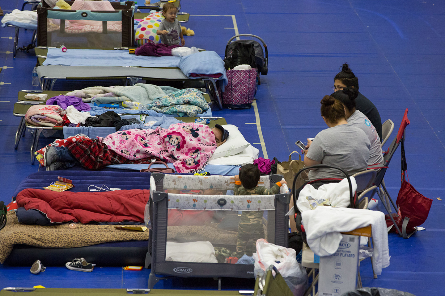 Evacuees from Hurricane Harvey take shelter at the Delco Center in east Austin, Texas on Sunday, August 27, 2017. (Suzanne Cordeiro/AFP/Getty Images) ...